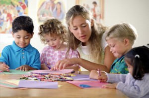 kindergarden-teacher-doing-crafts-with-students