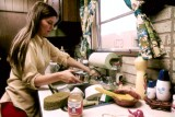 HOUSEWIFE_IN_THE_KITCHEN_OF_HER_MOBILE_HOME_IN_ONE_OF_THE_TRAILER_PARKS._THE_TWO_PARKS_WERE_CREATED_IN_RESPONSE_TO..._-_NARA_-_558298