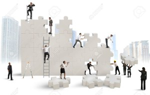 31364187-Business-team-Builds-a-new-company-with-puzzle-Stock-Photo