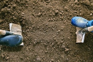 concept-agricultural-work-male-female-feet-rubber-shoes-digging-ground-shovels-earth-view-above-118344469