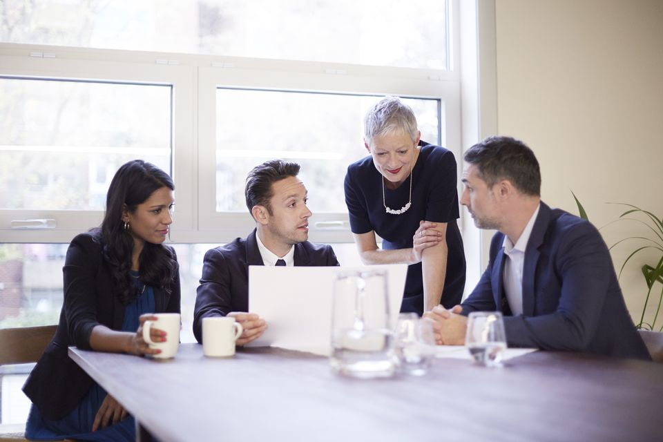mature-business-woman-in-a-meeting-with-employees-528913603-58419b8e5f9b5851e50f621f